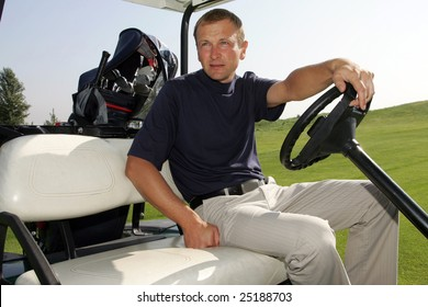 A golfer driving the golf carts