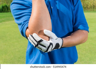 Golfer elbow pain during the game, muscle injury concept.