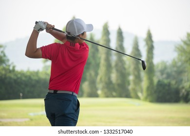 Golfer golfing. View from the back.
