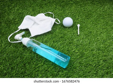 Golfer hand  golf ball with face mask hand gel to preparing for corona virus before go to golf course
