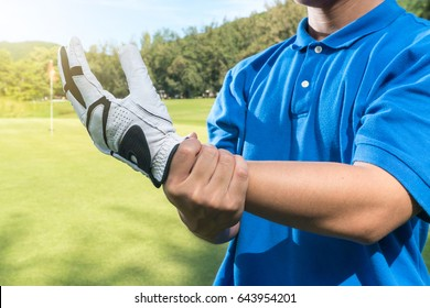 Golfer hand wrist injury, sport accident pain concept.