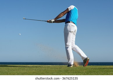 Golfer hitting ball with force. The grass distribution The blur of golf