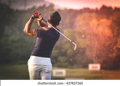 Golfer hitting golf shot with club on course vintage color tone