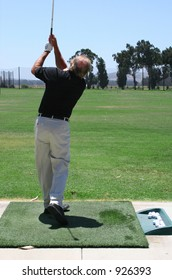 Golfer holding swing