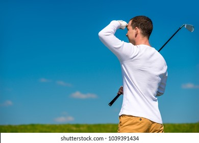 golfer looking afar trajectory of flying his ball in the open air