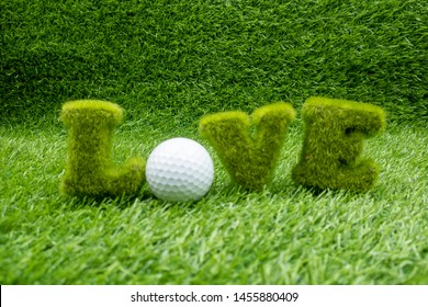 To golfer with love golf ball on green course