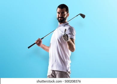 Golfer man with thumb up over colorful backgound