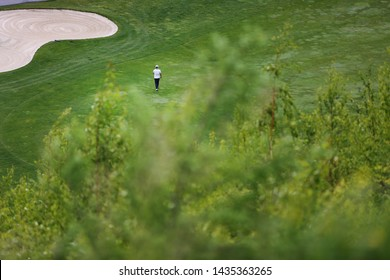 a golfer on the green grass