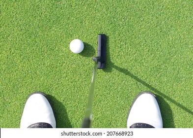 Golfer on training putt golf ball