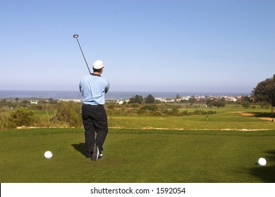 Golfer playing golf on the tee box. Copy space.