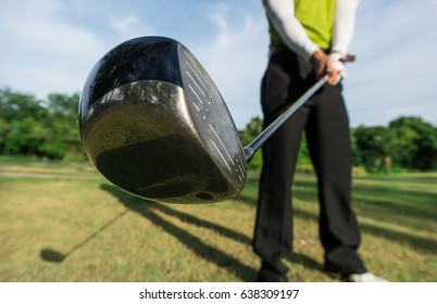 golfer prepare swing golf ball by club driver