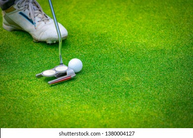 Golfer putting golf ball on green into hole of open tournament, winner shot of the day on beautiful green of golf course, favorite sport for businessman on vacation holiday summer