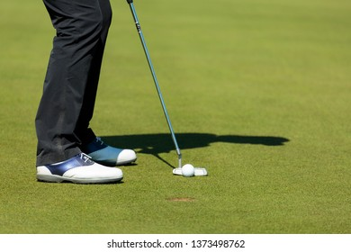 Golfer shadow with putter