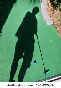 Golfer silhouette with putter