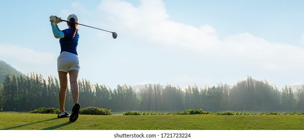 Golfer sport course golf ball fairway. People lifestyle woman playing game golf tee of on the green grass sunset background. Asia female player game shot in summer. copy space banner