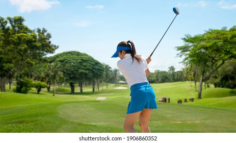Golfer sport course golf ball fairway. People lifestyle woman playing game golf tee of on the green grass. Asia female player game shot in summer. Healthy and Sport outdoor