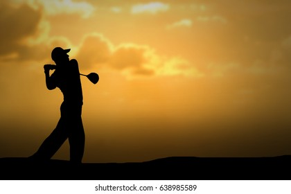 Golfer swing hit golf ball, silhouette sunset scene, copy space on Right side.