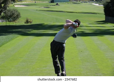 golfer swing in pebble-beach golf course, california