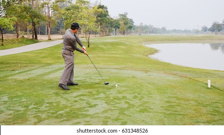 Golfer swings on tee shot for practice before hit the ball
