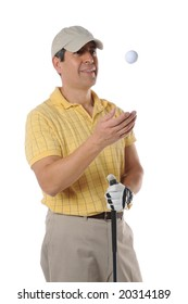 Golfer tossing a ball isolated on a white background