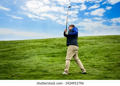 Golfer trying to make the perfect shot with a golf club