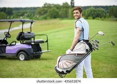 Golfer walking with golf bags