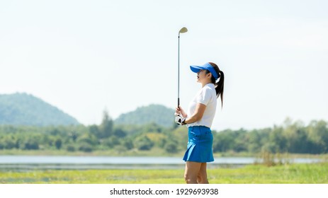 Golfer women sport course golf ball fairway. People lifestyle woman playing game golf tee of on the green grass. Asia female player game shot in summer. copy space banner