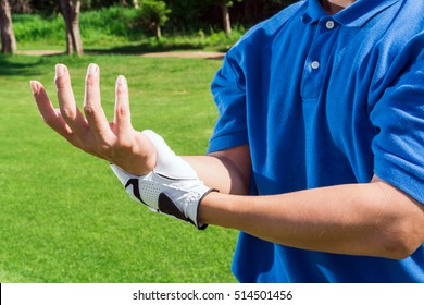 Golfer wrist pain during the game, muscle injury concept.