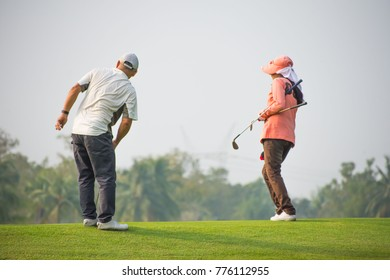 Golfers and golfers.