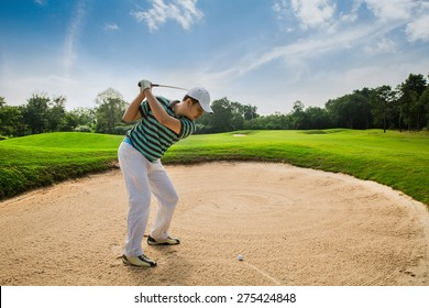 Golfers are hit Ball on the sand courts