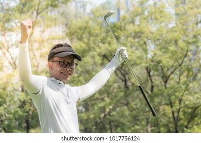 Golfers show joy The results of the successful play. With blurred soft nature background
