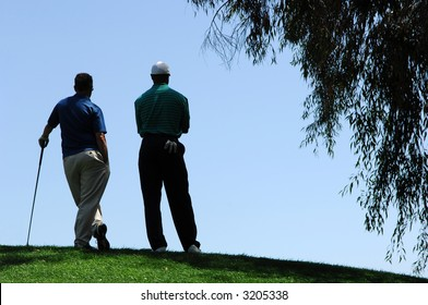 Golfers Stand At Top of Elevated Green at Tijeras Creek