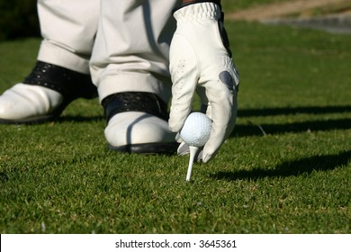 golffer getting ready to tee off