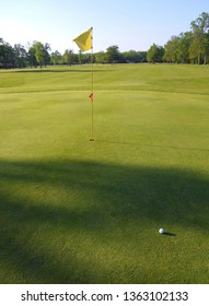 Golfing on a golf green putt country club  resort course with flag and ball