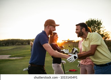 Golfing partners shaking hands after a game of golf