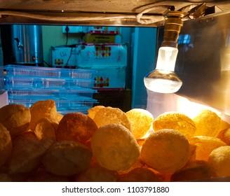 Golgappa chaat fuchka in glass box kept crisp by light bulb heat