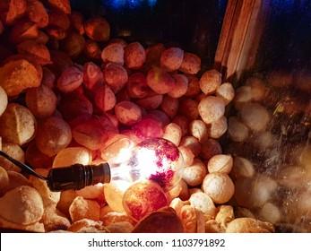 Golgappa chaat potato fry chop alu chop jhuri papdi fuchka in glass box kept crisp and warm dry by light bulb heat