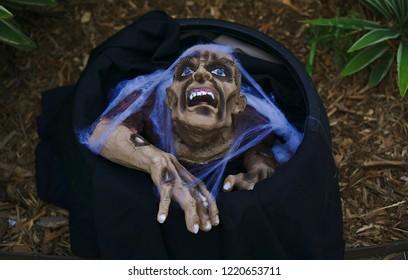 Gollum like puppet in purple colored cobwebs
