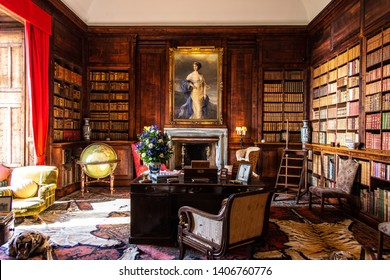 Golspie, SCOTLAND - Aug, 2018:Beautiful old style and classy office room with a lot of old books, a desk, chairs, carpets, and a vintage globe.