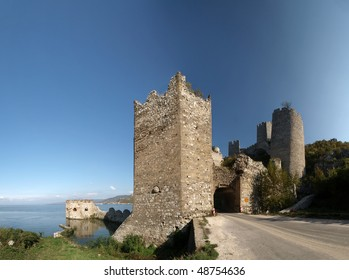 Golubac Fortress  panorama.  12th century castle located at the entrance of river Danube IRON GATE gorge. Main tower gate with fortified river dock on the left and rest of the towers on the right