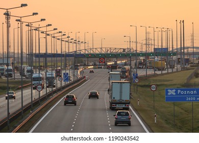 "GOLUSKI, POLAND - SEPTEMBER 28, 2018. Toll collection point on the Polish ""A2"" highway in sunrise scenery."