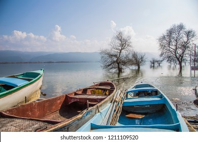 Golyazi Village, Bursa, Turkey - March 2015: A view of the lake and some fishing boats floating on the shore.