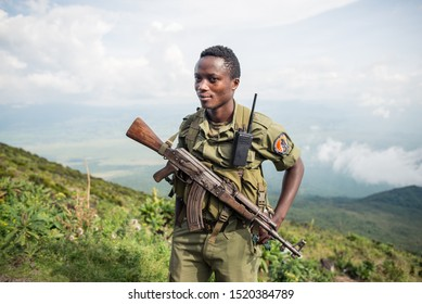 Goma / Democratic Republic of the Congo – October 13, 2016: Congolese National Park Ranger carrying AK47 rifle on the way to Nyiragongo volcano protecting tourists