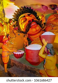 Gombak, Malaysia - 10/9/20: Diorama depicting a reclining Lord Rama being attended to by some of his many attending devotees. Location is the Ramanyana Cave.