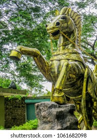 Gombak, Malaysia - 10/9/2016: Detail of a single bronze horse, part of the team of twelve, that pulls the chariot of the Hindu god Vishnu at the Ramayana Cave, part of the Batu Cave Complex.