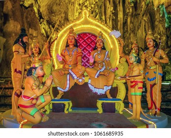 Gombak, Malaysia - 10/9/2016: Diorama of Lord Rama and his wife Sita sitting on their throne being attended to by devotees. Ramanyana Cave in the Batu Cave Complex.