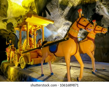 Gombak, Malaysia - 10/9/2016: Diorama of Lord Rama riding in his covered chariot throne in the Ramayana Cave, part of the Batu Caves Complex.