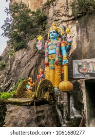 Gombak, Malaysia - 10/9/2016: The Hindu god Vishnu, second in the triumvirate represents sun and light, stands at the entrance to Ramayana Cave at the Batu Cave complex.