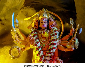 Gombak, Malaysia - 10/9/2016: Hindu god Lord Hanuman depicted with five heads and ten arms in the Ramayana Cave, part of Batu Caves.