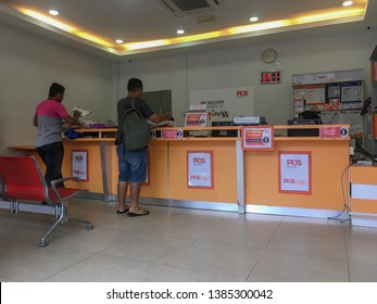 Gombak, Malaysia - April 27, 2019: Customer queue at the service counter of Pos Malaysia.